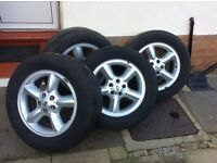 Four alloys wheels and tyres for series 2 Landrover discovery