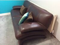 Large three seater brown leather sofa in immaculate condition