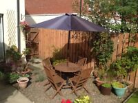 Garden patio wooden table and four chairs with parasol