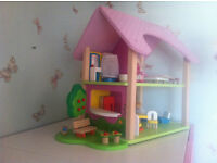 Dolls House with furniture and 2 dolls