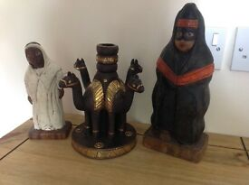 3 Arab style figures.