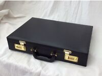 Briefcase, black leather effect. In unused condition.
