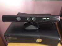Xbox 360 console ,comes with Kinect ,9 games ,2 controllers has all the cables and the box