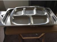 2 Stainless steel serving trays.