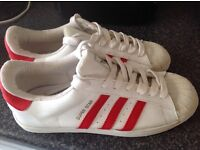 Adidas Super Stars in white with Red stripes. Size 10