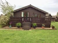 Lake view Wooden Lodge Holiday Home. Located on the Cotswolds Hoburn Park