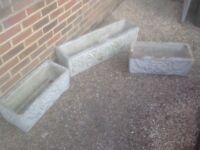 Three solid concrete garden troughs