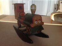 Handmade painted wooden rocking train