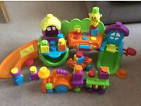 Fisher Price stacking surprise song & smiles silly town and train