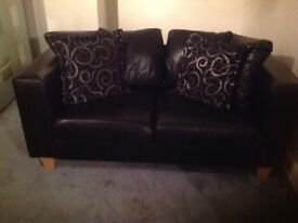 "2 seater black leather setee 2xcushions, 34"" deep back to front of arm, 64""long,seat depth 27"""