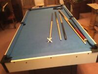 Free standing pool table. 3 cues,rest and full set of balls 37ins by 70ins