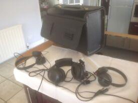 Pilot's case and various headphones
