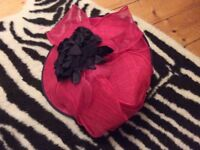 Pink formal hat with black flowers
