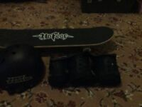 Skateboard and helmet with wrist, knee and elbow guards! Used once!