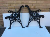 Black painted wrought iron bench ends.