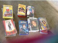 25 original video tapes including Harry Potter , home alone ,Matilda etc.