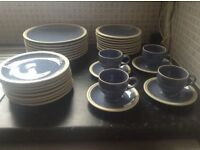 Light blue Rayware plates, cups and saucers. No chips. Usual wear and tear.