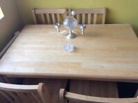 A lovely solid wood table and 4 chairs