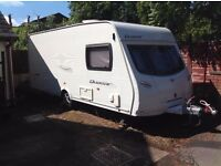 Lunar Quasar 525 Caravan complete with awning and accessories.