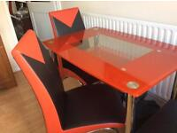 Table and 4 chairs. Back on sale due to time waster