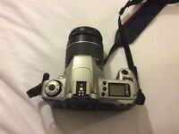 Canon camera SLR with 70mm zoom lence