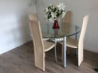 Substantial glass extendable dining table ex Andersons of Inverurie