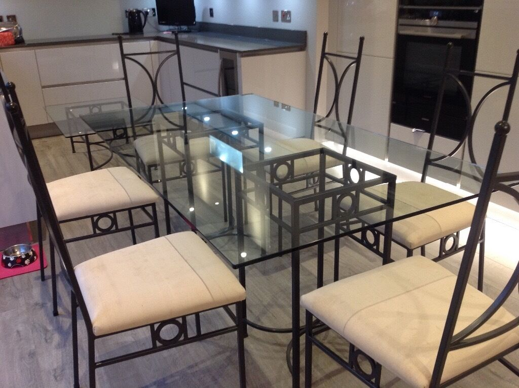 Metal and glass dining table and 6 chairs coffee table and