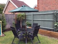 4 seater outdoor dining set and umbrella.
