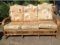 Conservatory furniture good soliid wicker 2 chairs one 3 seater sofa.
