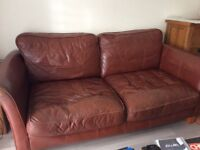 Brown 3 seater leather sofa for sale.