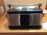 Sous Vide Multicooker model 17886, stainless steel with non stick liner and instructions book.