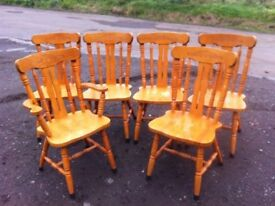 Set of six pine dining chairs including one carver