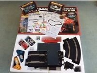 Formula One Scalextric set with 2 extra racing cars made by Hornby