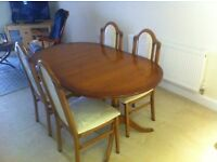 Extendable dining table and chairs x6. In excellent condition.