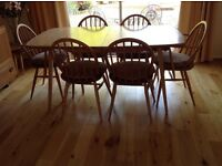 ERCOL light oak dinning table plus 4 chairs and 2 Carvers. Plus sideboard ..