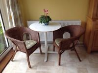 Two natural wicker chairs in very good condition.