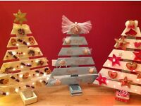 Hand crafted and individually decorated wooden Christmas trees