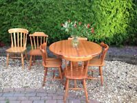 QUALITY EXTENDING PINE TABLE AND FOUR CHAIRS -can deliver