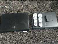 Two Sky boxes and remote controller