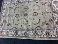 Lovely large Dunelm rug. Beige. Oriental design. Hardwearing easy clean synthetic material.