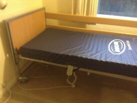 Profiling bed with matress and memory foam topper