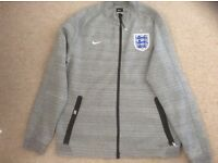 Nike Men's England (football ) lightweight jacket. Size large.