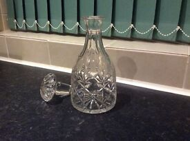 Crystal decanter, circular base, unwanted gift