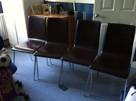 set of six brown leather dining chairs
