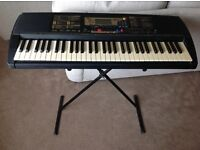 Yamaha PSR-225 electronic keyboard with stand.