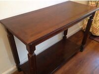Dark wood hall table in excellent condition. 69cm tall, 97 cm wide, 33cm deep.