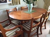 Dining table, four chairs and two carver chairs will also extend to accommodate all six chairs.