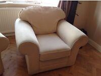 2 cream armchairs