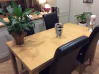 Extending dining table (excluding chairs)