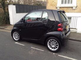 Lovely Black Smart Car with red interior for sale, excellent condition, low mileage, diesel